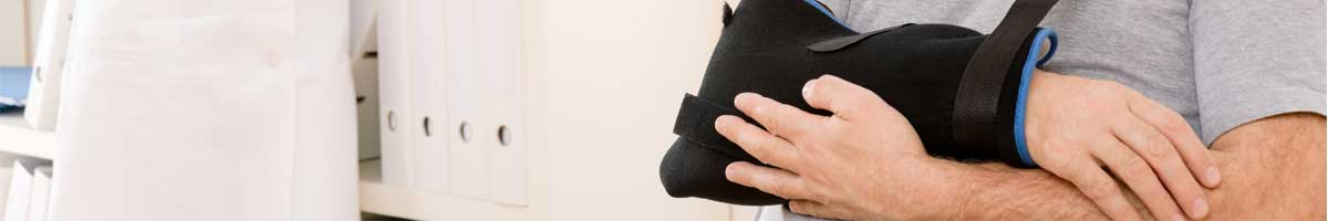A man with an injured arm in a sling will need to discuss his case with an Indianapolis car accident attorney